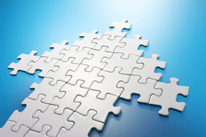 white puzzle pieces are connected together to form an arrow, they sit on a blue surface